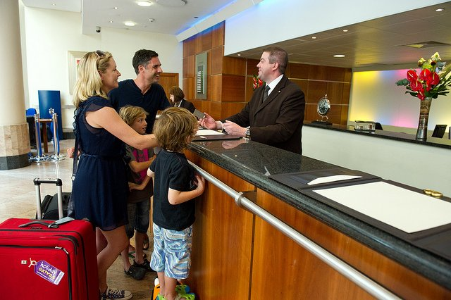 family at hotel front desk